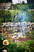 Tripod over fire pit in garden