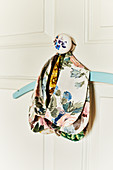 Collar of floral fabric on coat hanger