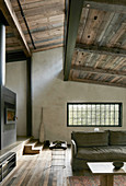 Rustic living area in earthy shades with exposed roof structure and clerestory windows