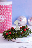Small wreath of box with number 1 for Advent candle