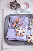 Sprig of flowers and snowflake biscuit decorating napkin