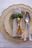 Napkin ring handmade from box leaves and golden tassel