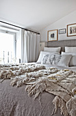 Blankets on bed in shades of beige