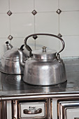Kettle on hob of traditional wood-fired cooker