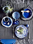 Blue and white place setting on anthracite-colored table