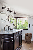 Twin sinks in washstand with marble top in bathroom