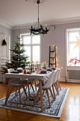 Set dining table in festively decorated dining room