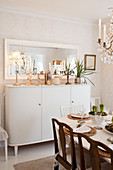 Tall sideboard with Christmas decorations in Scandinavian dining room