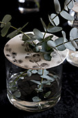 Eucalyptus twigs in vase with perforated lid made from modelling clay