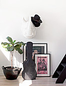 Rhinoceros hats on paper mache, posters, guitar and houseplant