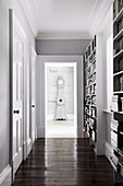 Classic hallway with bookshelves and cassette doors to the grandfather clock