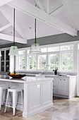 Modern country kitchen in light gray with kitchen island and open roof