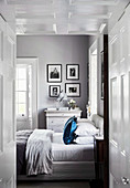 Paneled passage to the elegant bedroom in gray