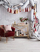 Balloons and Tassel garland as a festive decoration above the serving trolley