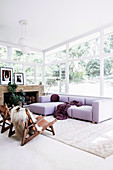 Purple sofa in the living room with all-round window front
