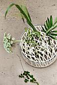 Metal grid for arranging plants in glass vase