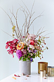 Colourful summer bouquet with astrantias, roses and orchids