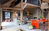 Open-plan, vintage-style interior in old farmhouse