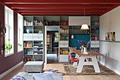 Bookcase surrounding door in modern dining room