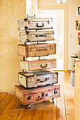 Handmade chest of drawers made from vintage suitcases and metal frame