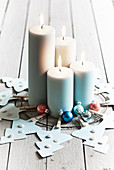 Handmade Advent wreath of paper Christmas trees and four lit candles