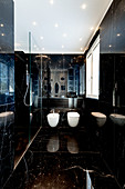 Modern bathroom with glossy black marble cladding