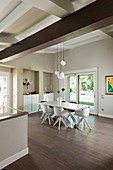 Modern dining room with high ceiling and beige walls