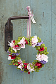 Wreath of peonies, sweet peas and ladies' mantel hung from vintage door handle