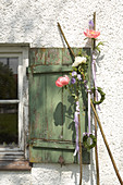 Vintage window shutter decorated with peonies