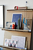 Various cards on DIY cardboard shelves