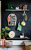 DIY coat rack made from shelves on black wall
