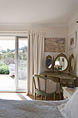 Baroque dressing table in bedroom with access to terrace