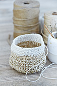 Storage basket crocheted from jute twine