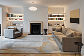Living area with fireplace and pale grey sofa set