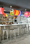 Colourful rubber rings above counter in bar