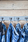 Denim clothing hung from hooks