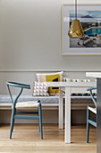 White dining table, classic chairs and fitted bench