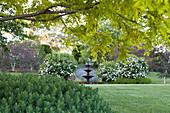 Three-tier fountain in a landscaped garden