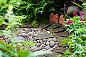 Circular pebbles and bricks in the garden
