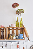Old wooden wine crates used as wall-mounted shelves in kitchen