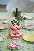 Muffins on cake stand on summery set table
