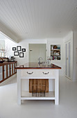 Island counter in large country-house kitchen with white floor