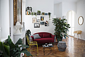 Eclectic living room with herringbone parquet floor in period apartment