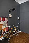 Yellow bicycles in foyer with grey walls and grey door