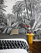 Wallpaper with jungle motif in black-and-white bedroom