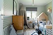 Scandinavian-style nursery in shades of grey