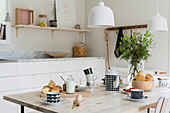 Casually set breakfast table in Scandinavian-style kitchen-dining room