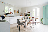 Large, light-flooded, Scandinavian-style kitchen-dining room