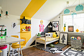 Colourful accents on walls in child's bedroom