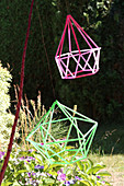 Geometric decoration made from colourful drinking straws in garden